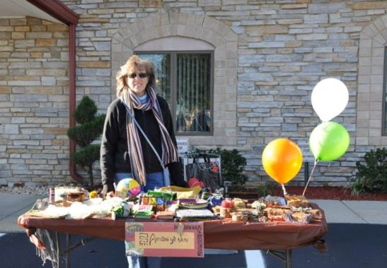 One of our Amani Volunteers hosting her sale.